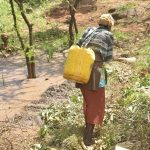 The Water Project: Kathungutu Community C -  Carrying Water