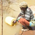 The Water Project: Kathungutu Community C -  Collecting Water
