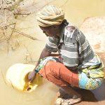 The Water Project: Kathungutu Community C -  Fetching Water