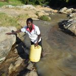 The Water Project: Yumbani Community A -  Carrying Container Filled With Water