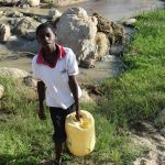 The Water Project: Yumbani Community A -  Carrying Water