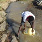 The Water Project: Yumbani Community A -  Filling Container With Water