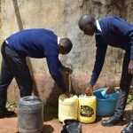 The Water Project: Mutulani Secondary School -  Students Fetch Water From Small Tank
