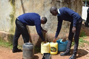 The Water Project:  Students Fetch Water From Small Tank