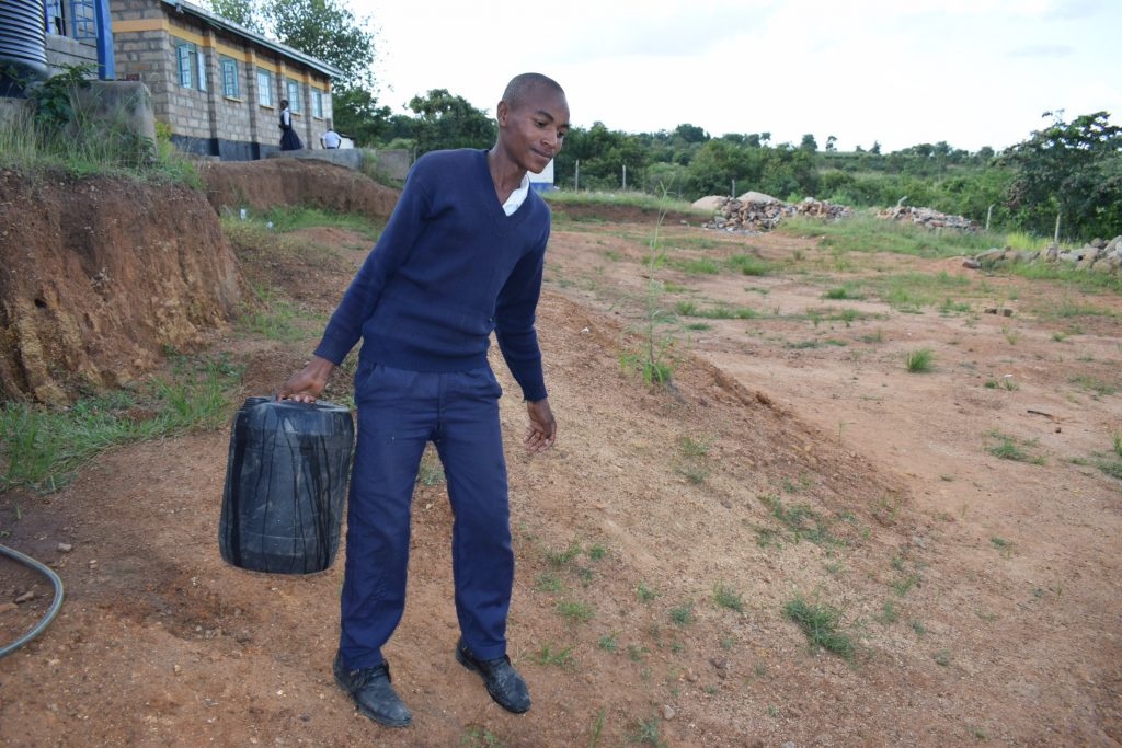 The Water Project : kenya20353-student-carrying-water
