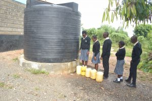 The Water Project:  Students At Small Plastic Water Storage Tank