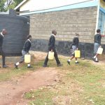 The Water Project: St. Paul Waita Secondary School -  Students Carrying Water