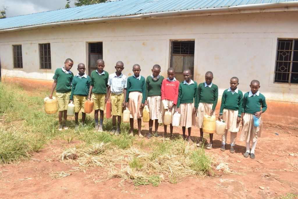 The Water Project : kenya20356-students-holding-water-containers
