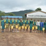 The Water Project: Ndithi Primary School -  Students Hold Water Containers