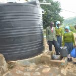 The Water Project: Mutwaathi Secondary School -  Collecting Water At Small Tank