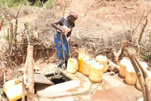The Water Project:  Collecting Water From The Well