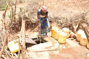The Water Project:  Hauling Water From The Open Well