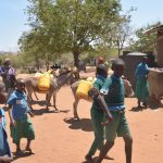 The Water Project: Kalatine Primary School -  Donkeys With Water Containers