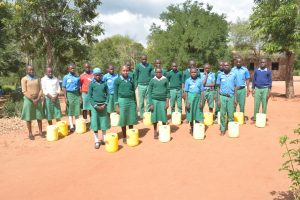 The Water Project:  Students Holding Water Containers