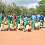 The Water Project: Kalatine Primary School -  Students Walk With Water Containers