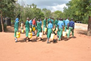 The Water Project:  Students Walk With Water Containers