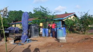The Water Project:  Fetching Water To Use For Drilling