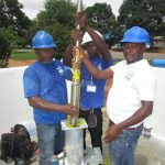 The Water Project: Transmitter, #14 Port Loko Road -  Inserting Cylinder Into Casing Pipes