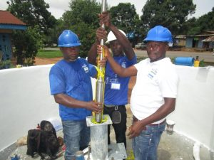 The Water Project:  Inserting Cylinder Into Casing Pipes
