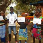 The Water Project: Transmitter, #14 Port Loko Road -  Participants Hold Up Training Materials