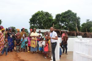 The Water Project:  Staff Member Discusses The New Well With Community Members