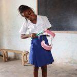 The Water Project: Lokomasama, Musiya, Nelson Mandela Secondary School -  Student Demonstrates Toothbrushing