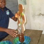 The Water Project: Lokomasama, Bompa, DEC Bompa Primary School -  Diarrhea Demonstration Using A Doll