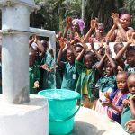 The Water Project: Lokomasama, Bompa, DEC Bompa Primary School -  Pupils Singing And Celebrating The Well