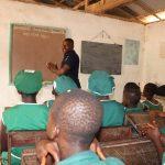 The Water Project: Lokomasama, Bompa, DEC Bompa Primary School -  Students Listen To Training Facilitator
