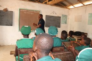 The Water Project:  Students Listen To Training Facilitator