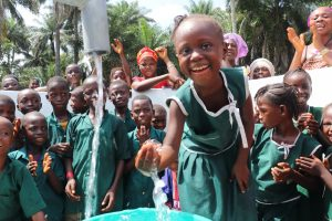 The Water Project:  Students With Their New Well