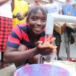 The Water Project: Lungi, Rotifunk, 1 Aminata Lane -  Young Girl Drinks From The Well
