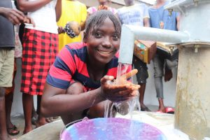 The Water Project:  Young Girl Drinks From The Well