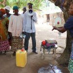The Water Project: Lungi, Yaliba Village -  Facilitator Teaches About Handwashing
