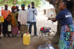 The Water Project:  Facilitator Teaches About Handwashing