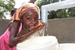 The Water Project:  Girl Drinks From The Well