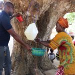 The Water Project: Lungi, Yaliba Village -  Old Woman Displaying How To Do Handwashing With Tippy Tap