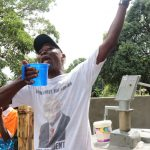 The Water Project: Lungi, Yaliba Village -  Sheika Turay Head Man Rejoicing For Safe Water