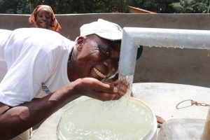 The Water Project:  Village Headman Drinks From The Well