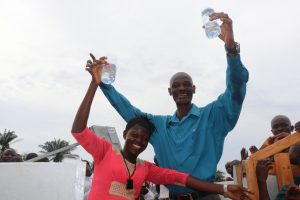 The Water Project:  Principal And Staff Member Celebrate