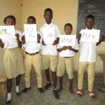 The Water Project: Lungi, Komkanda Memorial Secondary School -  Students Hold Up The Training Materials