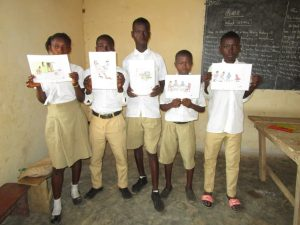 The Water Project:  Students Hold Up The Training Materials