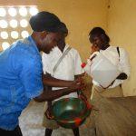 The Water Project: Lungi, Komkanda Memorial Secondary School -  Teacher Demonstrates Handwashing
