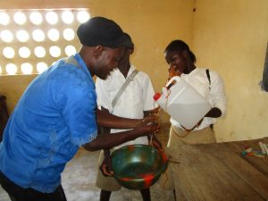 The Water Project:  Teacher Demonstrates Handwashing