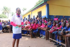 The Water Project:  School Head Girl Demonstrating How To Clean Teeth