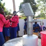 The Water Project: Lungi, Lungi Town, Holy Cross Primary School -  Student Pumping Water