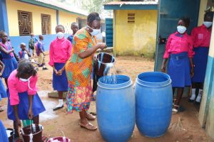 The Water Project:  Teacher And Pupils Cleaning The School Compound