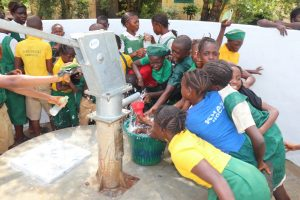 The Water Project:  Students Play At The Well