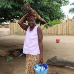 The Water Project: Sulaiman Memorial Academy Jr. Secondary School -  Old Woman Carrying Banana Stem