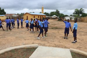 The Water Project:  Students Outside Class Room